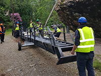 Mini crane lift allows tourists to 'boulder-ly go' up giant rock