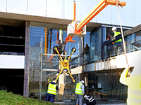 Counterbalance lifting beam supports council glass installation